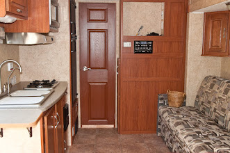 Photo: View of the galley and living area.