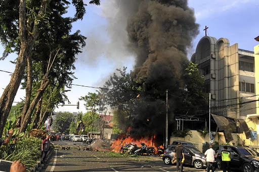 Bombed: The wreck of the car that crashed into the Pentecost Church Central Surabaya, in the Indonesian city of Surabaya on Sunday. Picture: REUTERS