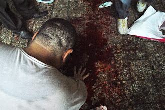 Photo: A man kneels over a pool of blood after violence breaks out during Friday's 'Day of Rage' protest. Clashes between police and protesters broke out shortly after the noon prayer, leading to at least 95 people being killed. Cairo, EGYPT - 16/8/2013. Credit: Ali Mustafa/SIPA Press
