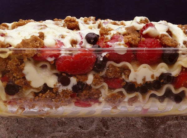 Dessert Lasagna - fresh strawberries, blueberries, raspberries and blackberries baked with ricotta, mascarpone, brown sugar and sour cream with either regular noodles or chocolate ones.