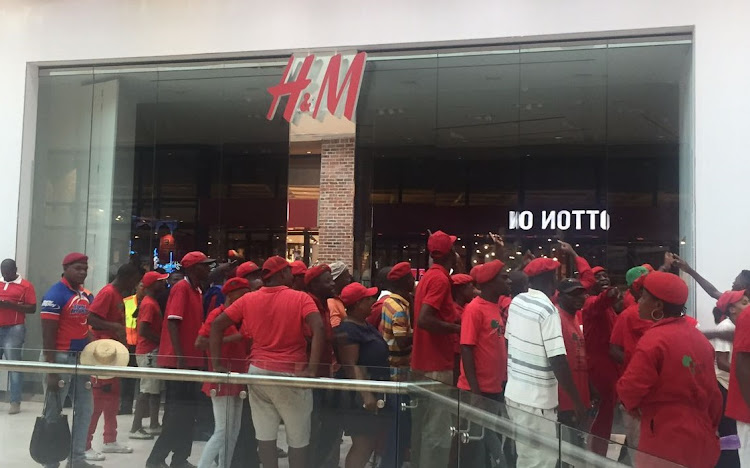 EFF members gather outside an H&M store at the Mall of Africa in Johannesburg.     Picture: SUPPLIED