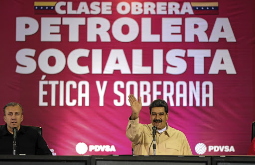 Venezuelan President Nicolas Maduro, right, and Vice-President Tareck El Aissami attend a meeting with workers of state-run oil company PDVSA in Caracas on June 5 2018. Picture: HANDOUT VIA REUTERS