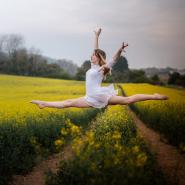 Take the leap by Vix Paine - Babies & Children Child Portraits ( straddle, jumping, dancers, pose, rapeseed field, dance photography, child dancer, dance move, yellow, ballet, sisters, bare feet, teenagers, flower, dancer, working together, colour, rapeseed, leap, family, sister, child, jump, teenager )