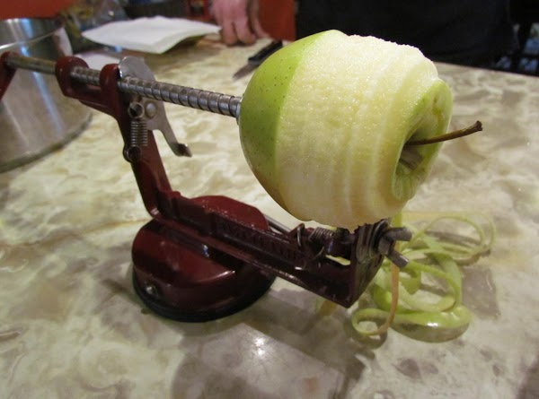 Peel, core and slice your apples. Hopefully you have a fancy gadget that does...