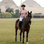 woman playing polo in cairo egypt over looking the abu seir pyramids
