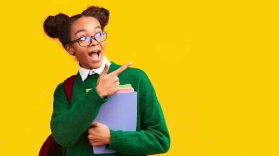 School Girl Pointing at YESS Logo