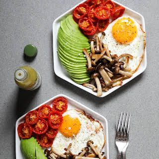Fried Eggs With Slow-Roasted Tomatoes, Avocado, and Mushrooms.