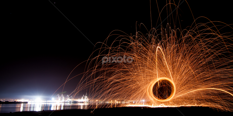 Playing with sparks by Jurica Železnjak - Abstract Light Painting ( lights, sparkles, steel wool, croatia, night, cityscape, sparks, pula, city )