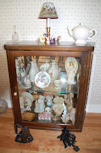 Photo: Day 64 ... Our homemade (by me) curio cabinet with 2 old fashioned irons on the floor