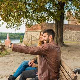 Selfie in the public park by Vera Arsic - People Couples ( young women, romance, two people, friendship, heterosexual couple, city life, togetherness, young adult, river bank, selfie, model, communication, smiling, attractive, tree, smart phone, telephone, lovers, lifestyles, girlfriend, enjoyment, color image, love - emotion, adult, photography, couple - relationship, city, boyfriend, affectionate, romantic, happiness, joy, grass, dating, flirting, caucasian ethnicity, wooden bench, public park, nature, carefree, sexy, intimate, young men, technology, people, young couple, outdoors, growth, fashion, laughing )