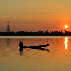 golden hour..... by Ashif Hasan - Landscapes Sunsets & Sunrises ( water, sky, waterscape, sunset, fishing, fisherman, boat, evening, people, gloomy, golden hour )