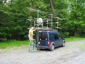 Photo: Terry W8ZN cranks up microwave mast - K8GP / Rover - FM09WX