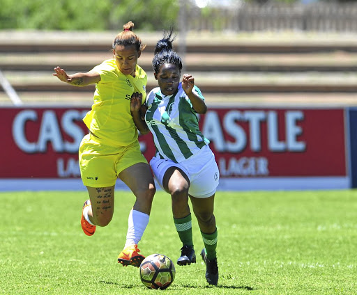 Jaime Lee Witbooi of UWC Ladies fights for the ball with Bloemfontein Celtic Ladies' Emily Moholoholo in the first day of Sasol League National Championships at Galeshewe , Kimberley, yesterday. / Sydney Mahlangu/BackpagePix