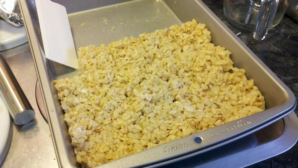 Add cereal and stir until well-coated. Using a buttered spatula or waxed paper, press...