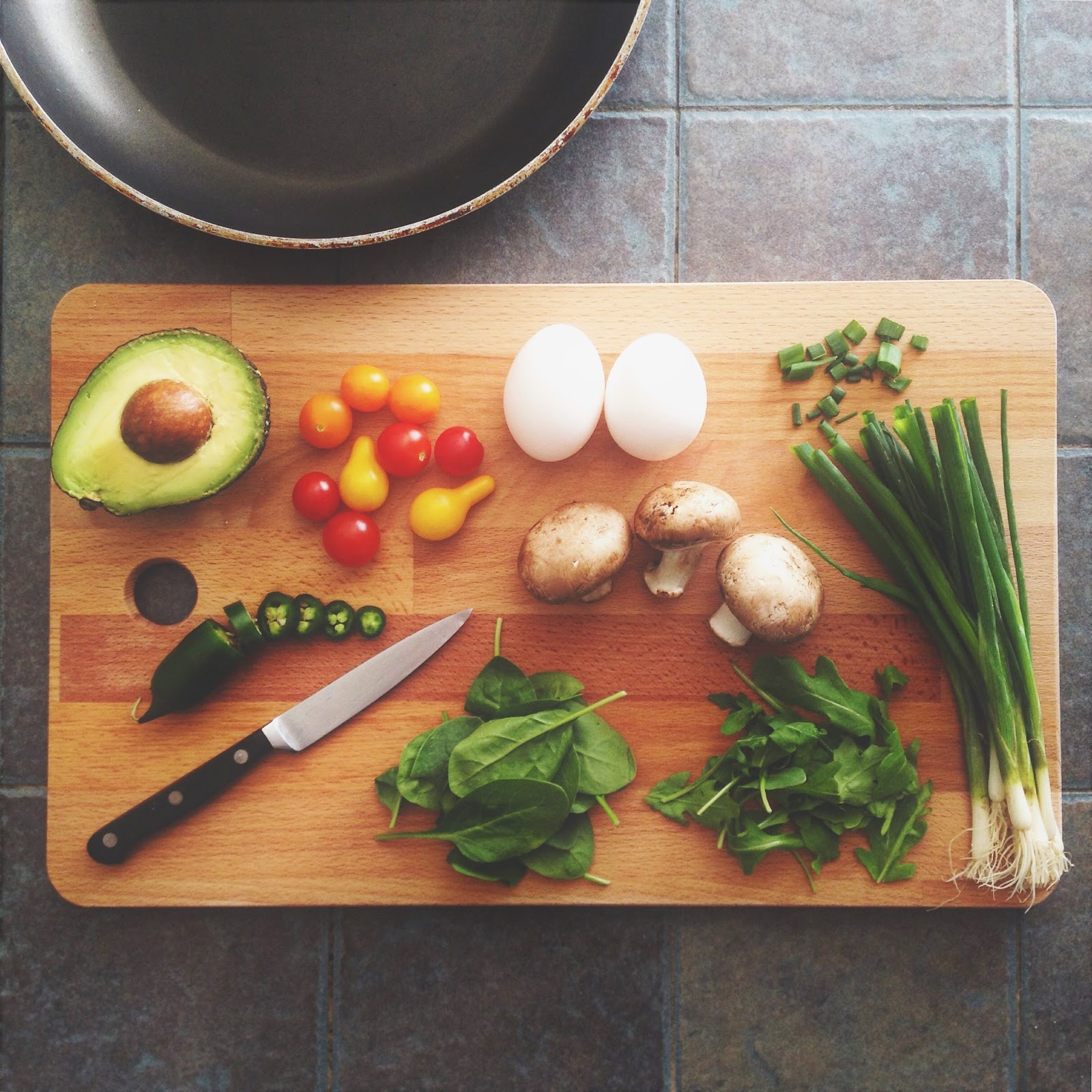 cutting board with different healthy food prep on it