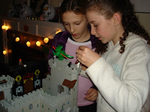 Photo: Two girls play with the Harry Potter theme at a party on Oct 31st