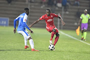 Peter Shalulile of Highlands Park and Zitha Macheke of Chippa United during the Absa Premiership match between Highlands Park and Chippa United at Makhulong Stadium on October 06, 2018 in Johannesburg, South Africa.