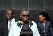 Zandile Gumede outside the Durban Magistrate's Court during her last court appearance in October. Behind her is her instructing attorney Bulelani Mazomba.