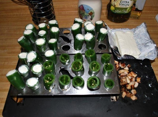 Place a little cream cheese (enough to fill maybe 1/4 of the pepper) in...
