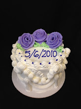 Photo: Lisa's traditional border with purple inscription & purple whipped cream frosting roses.