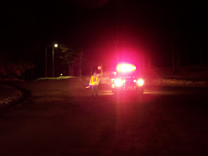 Photo: Firefighter wearing traffic control reflective gear with ALL lighting on apparatus turned on causing glare for oncoming vehicle