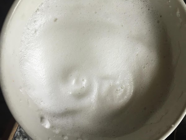 Beat egg white in a bowl until frothy and soft peaks are just beginning...