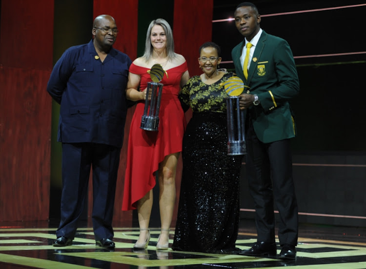 Dane van Niekerk and Kagiso Rabada, winners of the main awards, with Cricket SA president Chris Nenzani and Sports Minister Toko Xasa during the Cricket South Africa Awards Banquet at Sandton Convention Centre on June 02, 2018 in Johannesburg, South Africa.