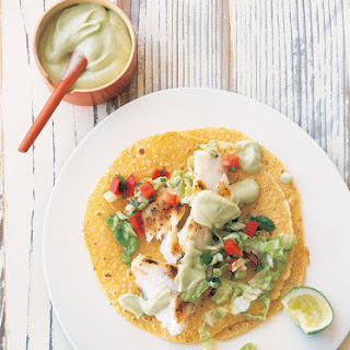 Fish Tacos with Cabbage Slaw and Avocado Crema.