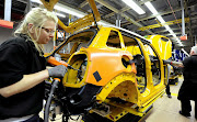 A woman working at a BMW factory producing Minis in Oxford, Britain.