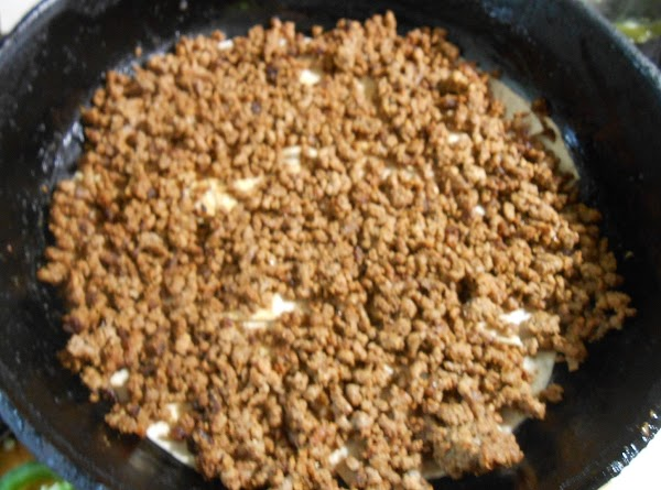 Spoon in cooked taco meat.
