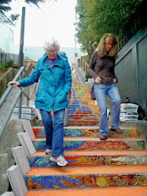Photo: Hidden Garden Steps (16th Avenue, between Kirkham and Lawton streets in San Francisco's Inner Sunset District) organizing committee members and other volunteers (left to right: Judy Goddess and Licia Wells), on Saturday, November 2, 2013, had their first onsite visit as installation of the 148-step ceramic-tile mosaic designed and created by project artists Aileen Barr and Colette Crutcher continued. For more information about this volunteer-driven community-based project supported by the San Francisco Parks Alliance, the San Francisco Department of Public Works Street Parks Program, and hundreds of individual donors, please visit our website at http://hiddengardensteps.org.