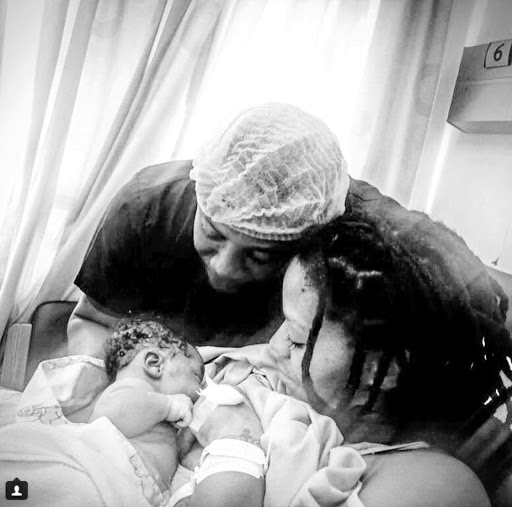 Letoya Makhene and partner Tshepo Leeuw with the latest addition to their family, Kopano Jordan Leeuw. / Instagram