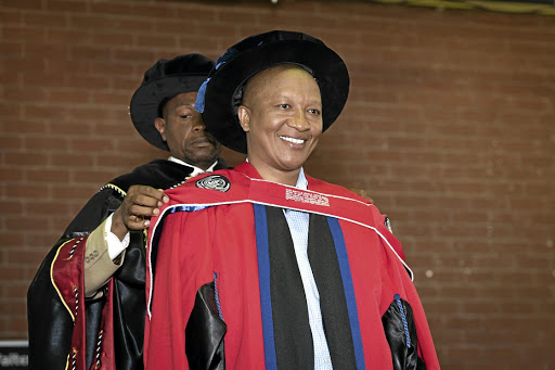 Sisa Ngebulana receiving an honorary doctorate in commerce.