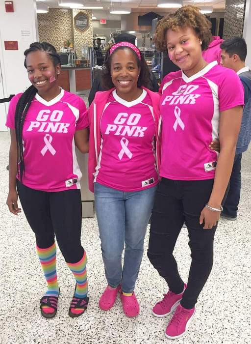 Mrs. Carter and students support the Mustangs Go Pink Campaign for Breast Cancer Awareness
