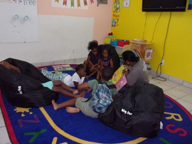 Staff from Fortis reading to children