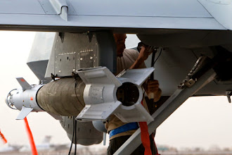 Photo: An aircrew member inspects the weapons loadout on an MQ-9 Reaper before it takes of for a mission in Afghanistan Sept. 31. (Courtesy photo)