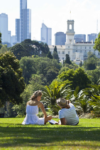 Melbourne-Royal-Botanic-Gardens-couple - A couple relaxes in Royal Botanic Gardens in Melbourne, Australia.