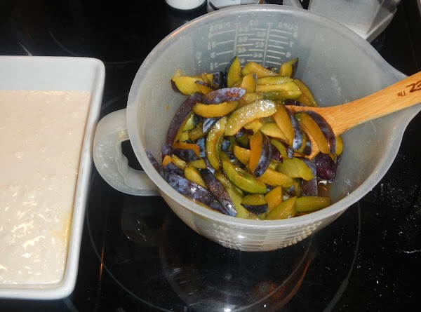 Add the plum mixture with a large spoon, so they cover the flour mix. DO...