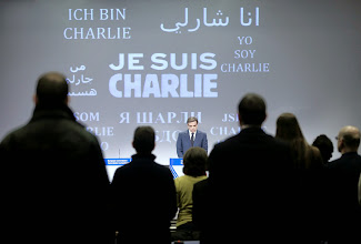 "Photo: epa04550747 "" Je suis Charlie"" in several languages during  minute of silence in the main press room of the European commission at the start of the midday Press briefing in Brussels, Belgium, 08 January 2015 in solidarity with those killed in the shooting of 12 people at the satirical magazine Charlie Hebdo. At least 12 people were killed 07 January 2015 in a terrorist attack against satirical French magazine 'Charlie Hebdo' in Paris.  EPA/OLIVIER HOSLET"