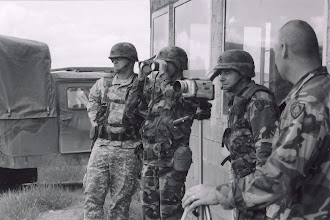 Photo: Calling in the final Call For Fire.  COL Leach (52nd TC), LTC McFarland, SGT Dubay, SFC Kervin