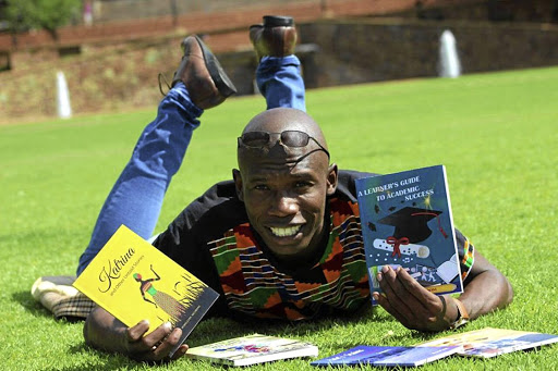 Mafule Moswane with the two books that he has written to help matrics.
