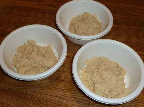 2. Divide dough into three separate bowls. Put a little more into one bowl...