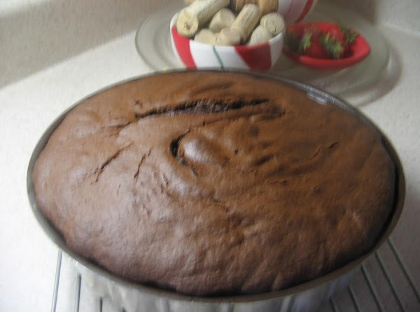 Make cake  using the eggs, water and oil. Beat 2 minutes, so it...