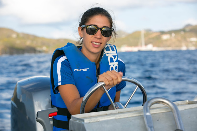 Caterina at the helm of a speedboat from Wind Surf in St. Bart's.