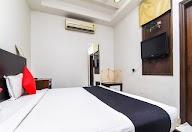 Capital O 1245 Hotel Amby Inn photo 7