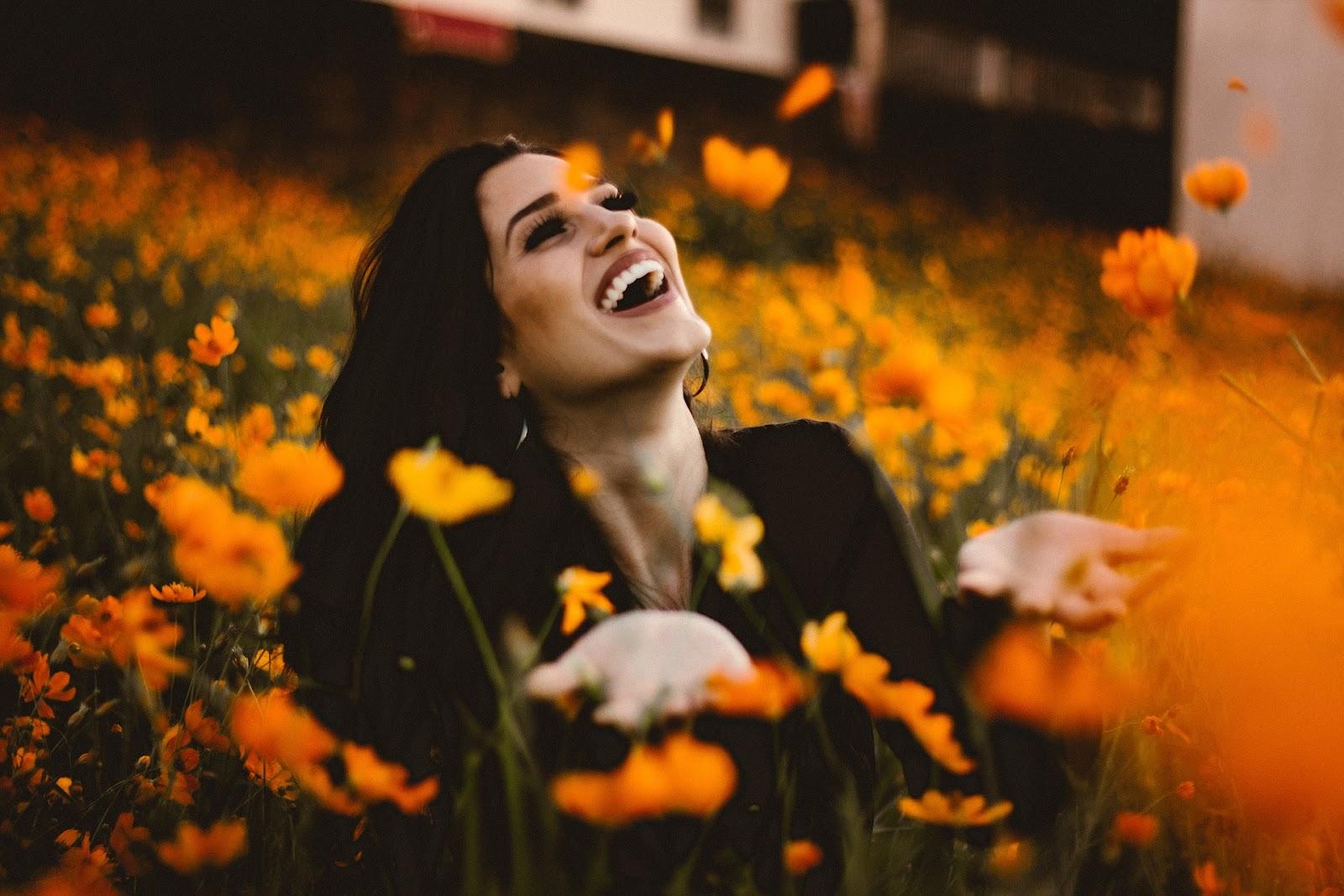 Happy woman among flowers