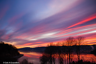 Photo: The sun sets early at our latitude in december and january, creating amazing colors when there are thin clouds. Drammensfjorden, South Eastern Norway.