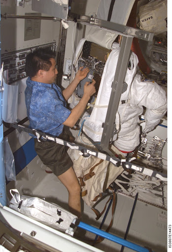 Expedition Seven Lu with EMU in Quest airlock