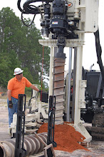 Photo: Talk about an auger! Talk about power!  John Martinuzzi, the southeast Geoprobe representative demonstratings its capabilities.