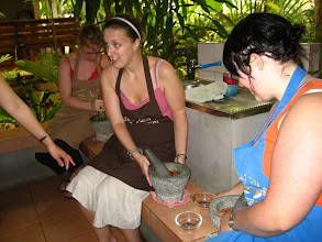 Photo: Rachel and Alice (from Tazie) pounding our some red chillie paste
